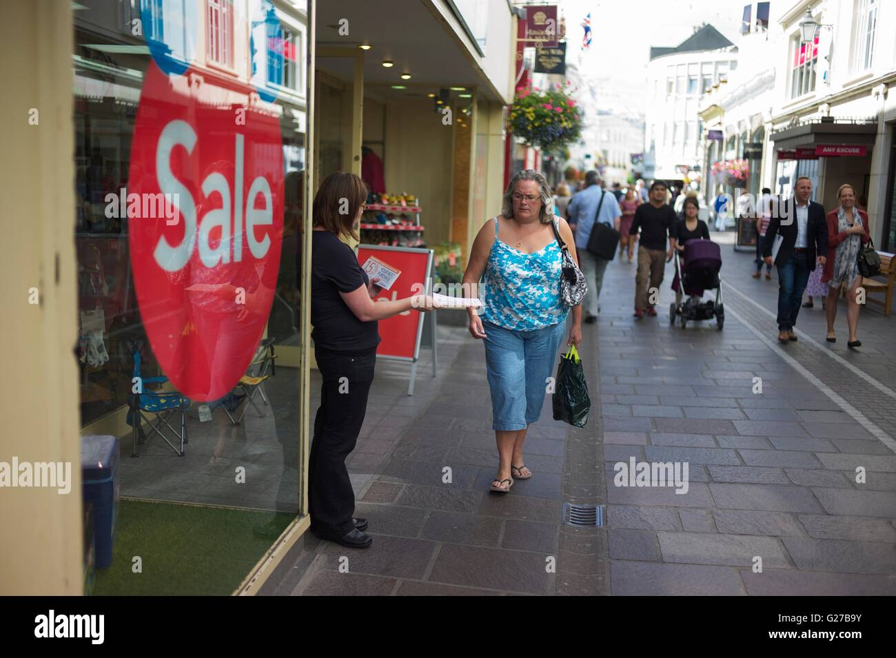 Sale signs showing how much the high street is struggling to make customers visit their stores and move away from - Stock Image
