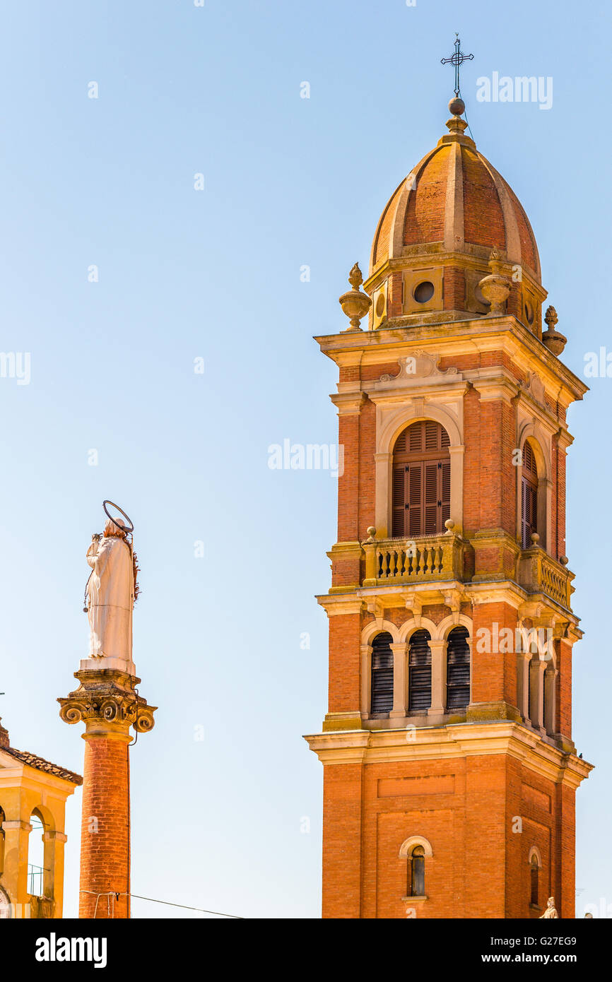 bell tower of Catholic church and statue of the Blessed Virgin Mary - Stock Image