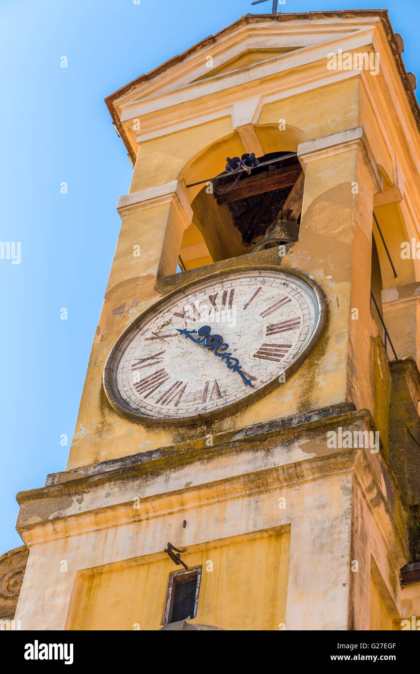 bell tower of Catholic church with clock - Stock Image