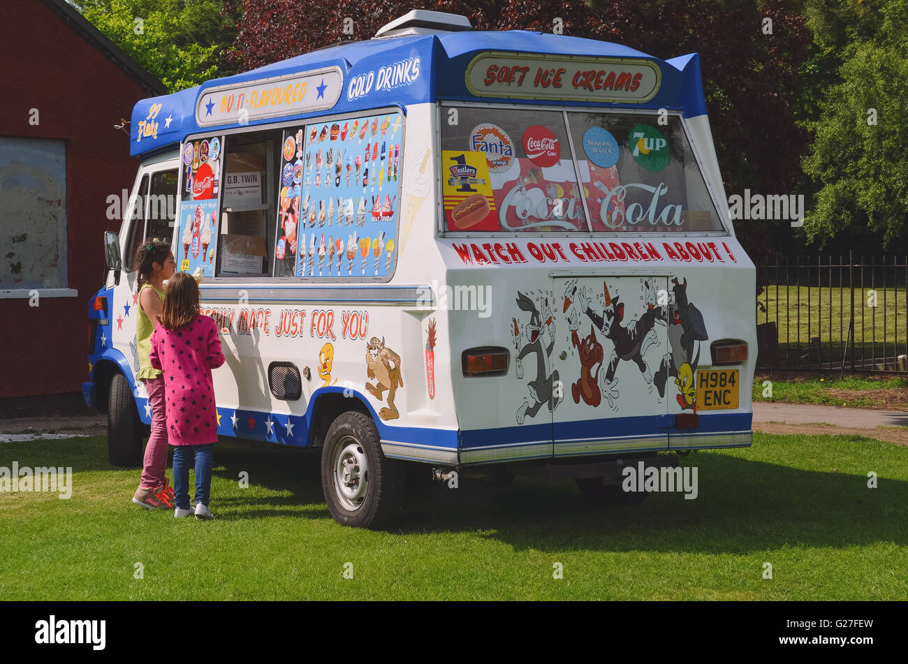 Ice Cream vintage van waiting for customer in fun fair - Stock Image