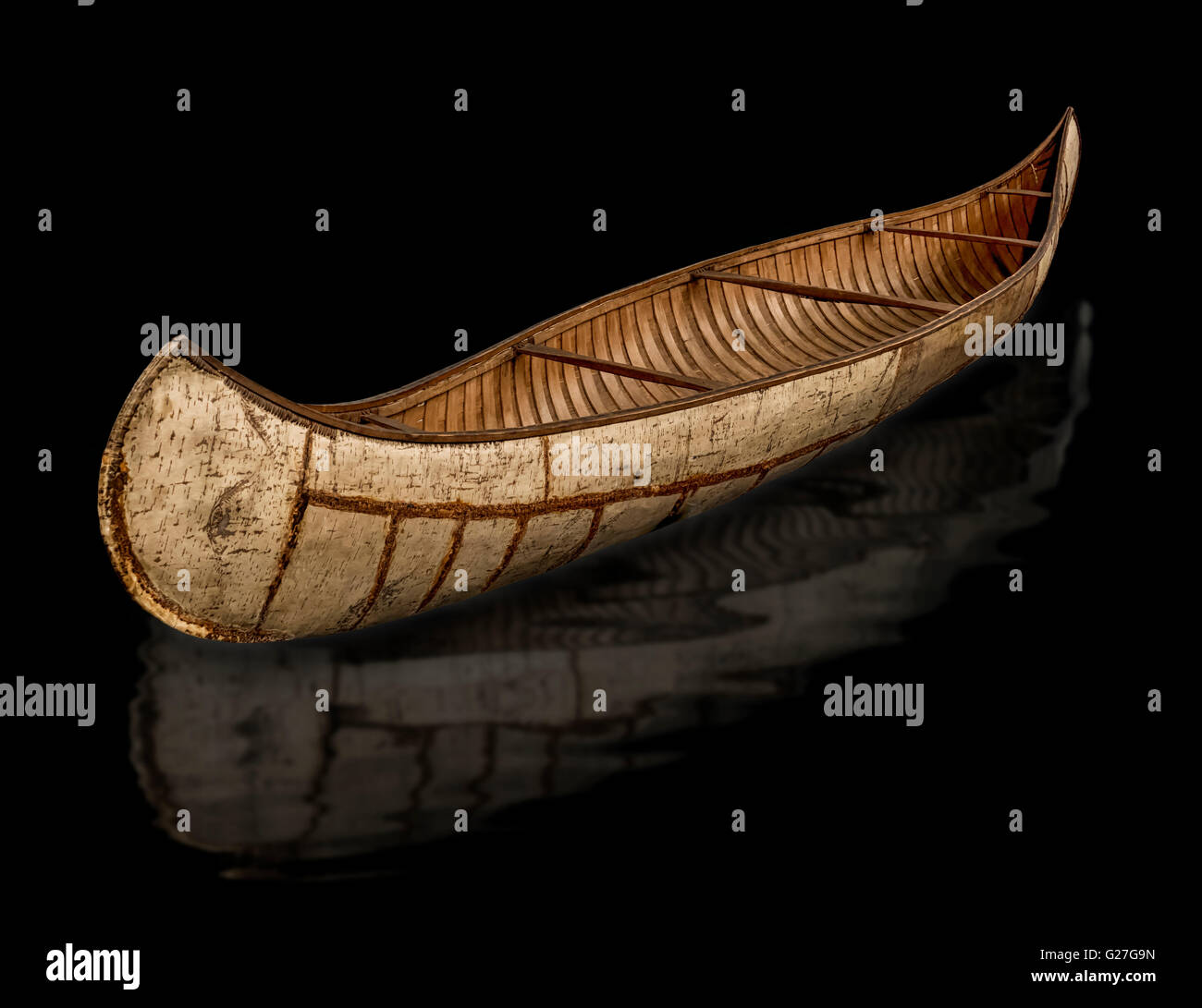 A crooked Birch bark canoe from the southern Hudson Bay area of Canada.Of the type built by the Cree Nation Tribes - Stock Image