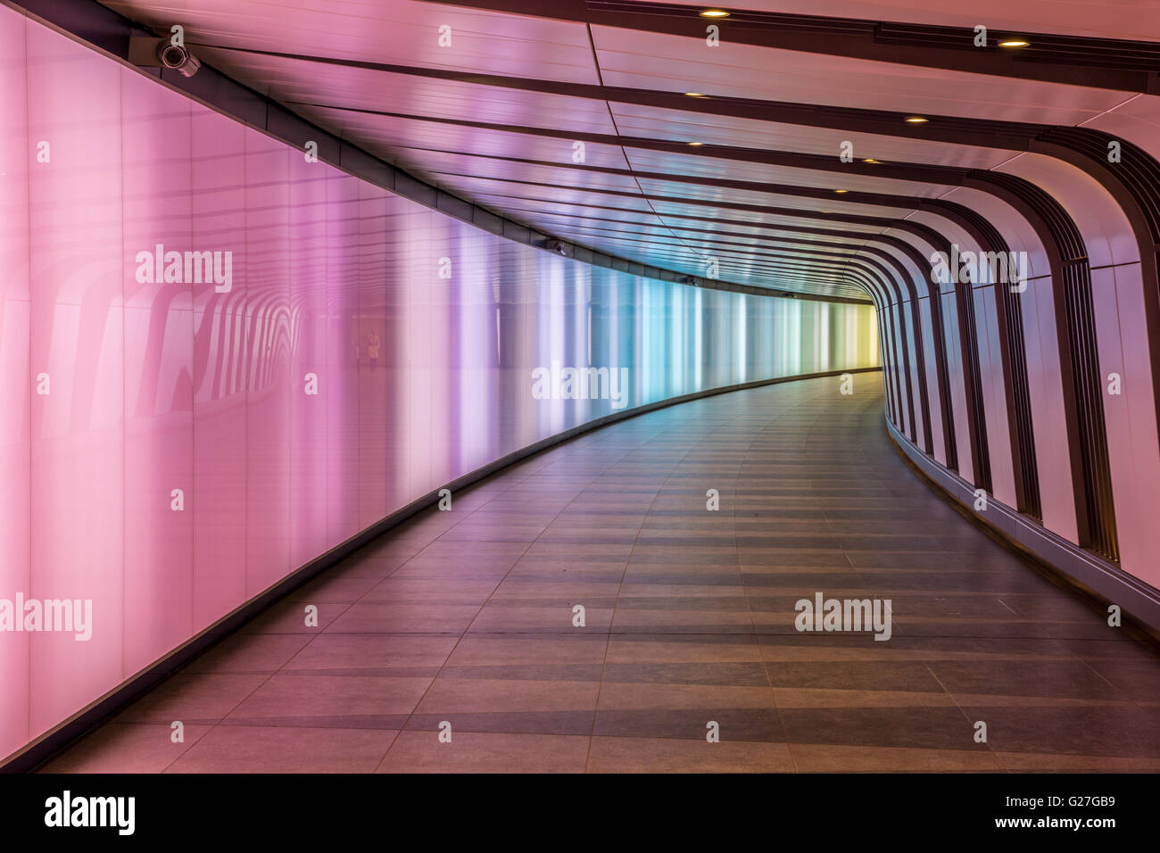 London, UK - May 20, 2017 - King's Cross futuristic looking tunnel, the 90 meters long curved pedestrian tunnel - Stock Image