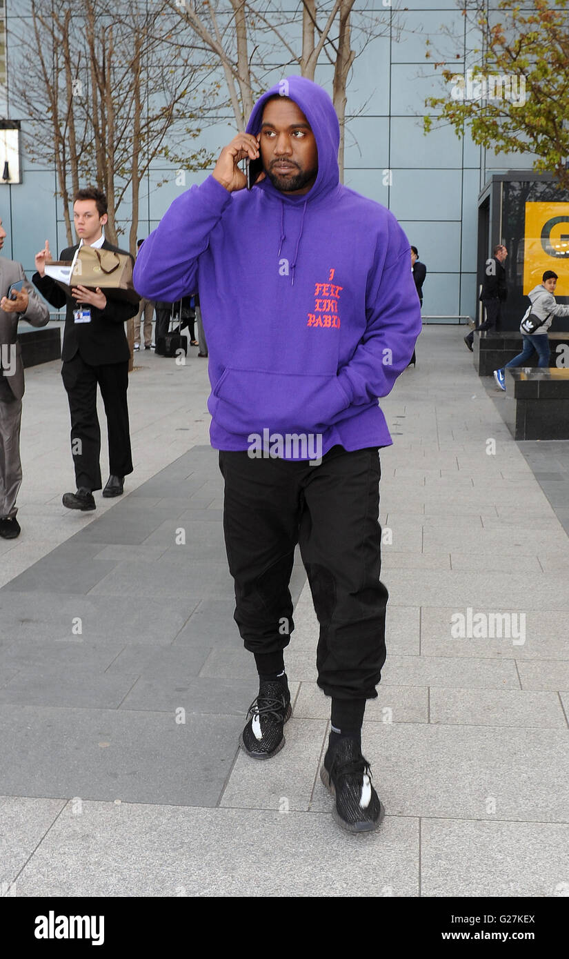 fb526d8963b80 Kanye West arriving at Heathrow Airport all smiles. Kanye was wearing an as  yet unreleased
