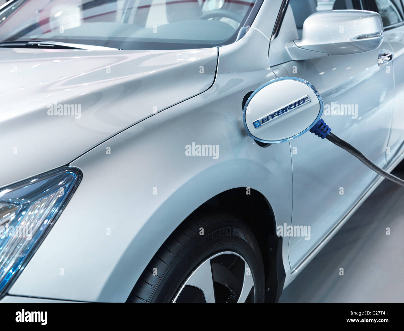 Plug-in hybrid electric vehicle Honda Accord recharging batteries at a charging station - Stock Image