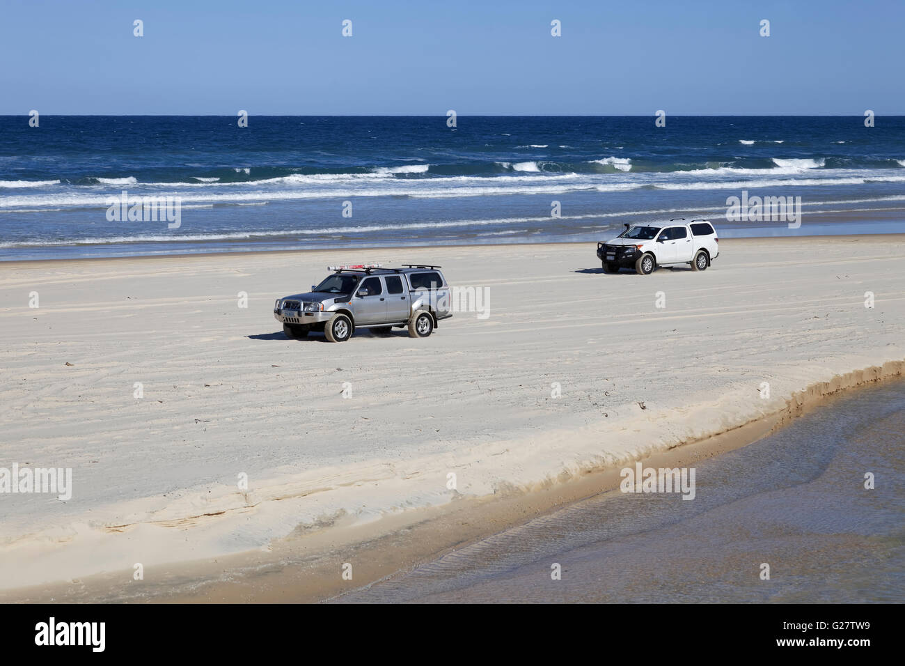 Car on 75 Mile Beach Road, official Highway, UNESCO World Heritage Site, Fraser Island, Great Sandy National Park, - Stock Image