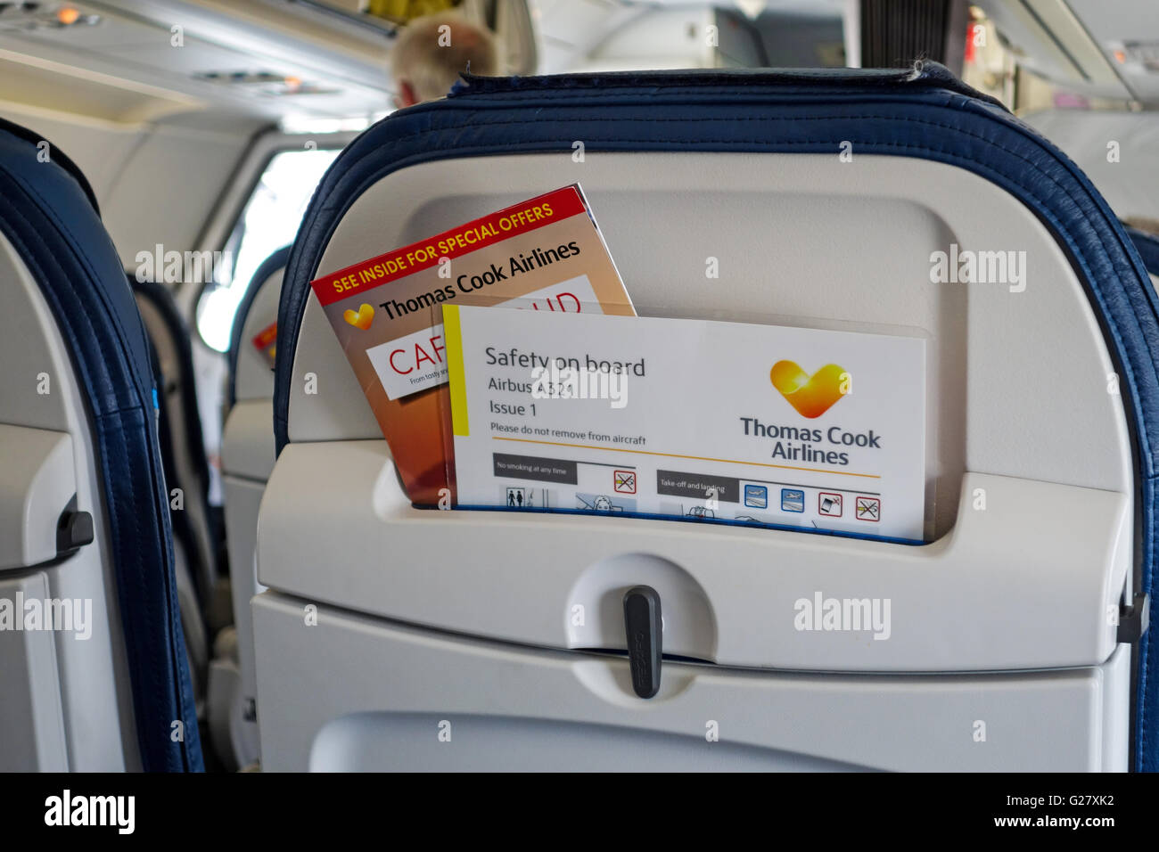 Safety instructions in the back of a seat on a Thomas Cook airlines Airbus A321 - Stock Image