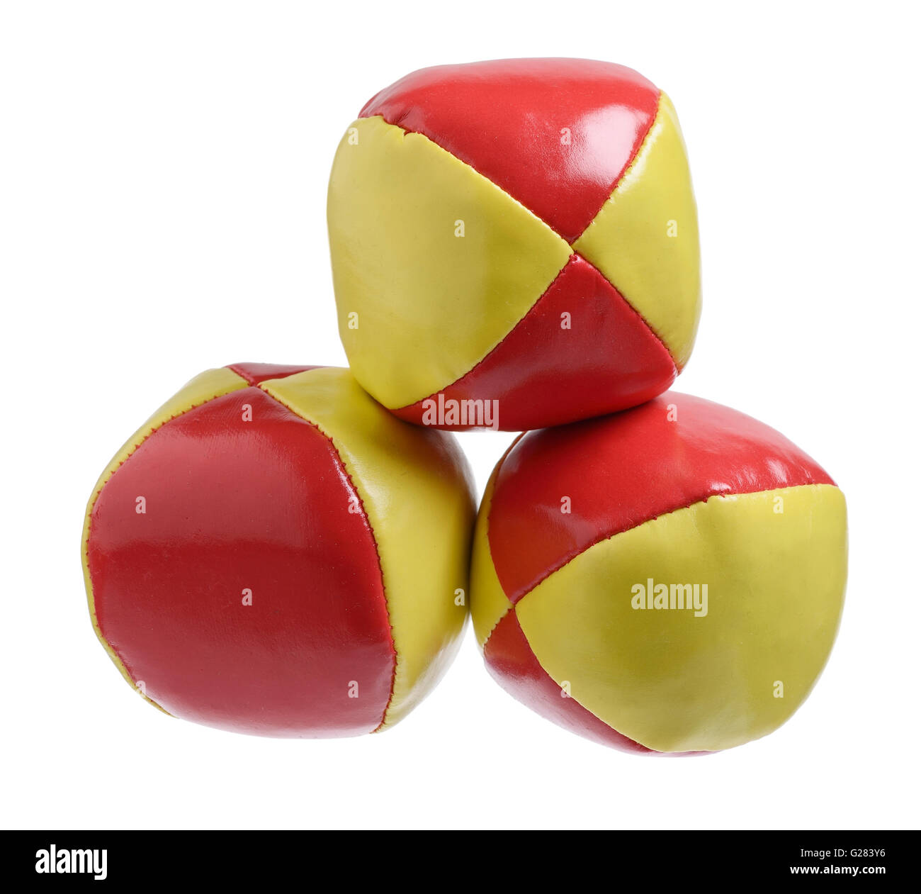 Three red and yellow juggling balls - Stock Image