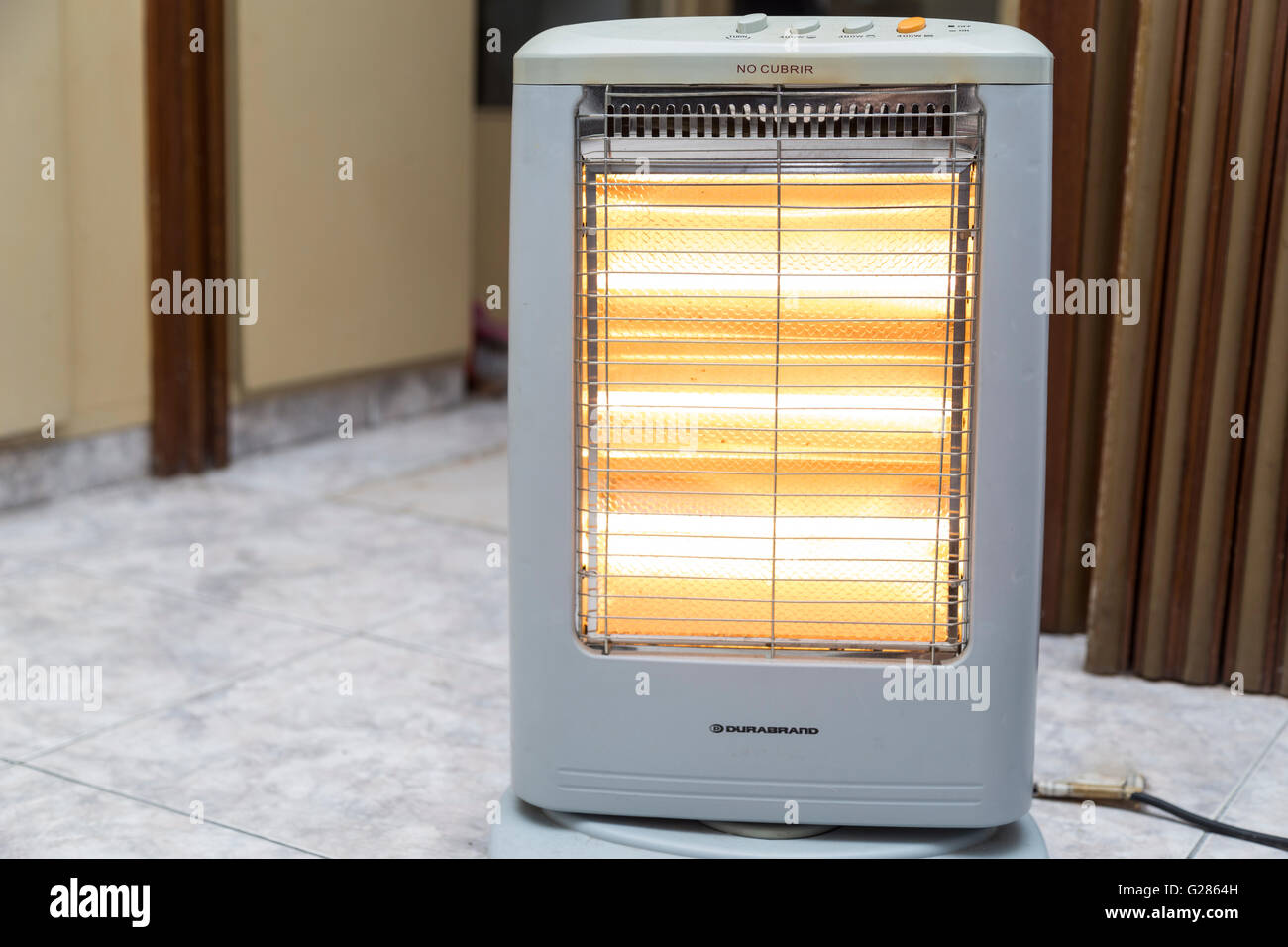Electric heater plugged in - Stock Image