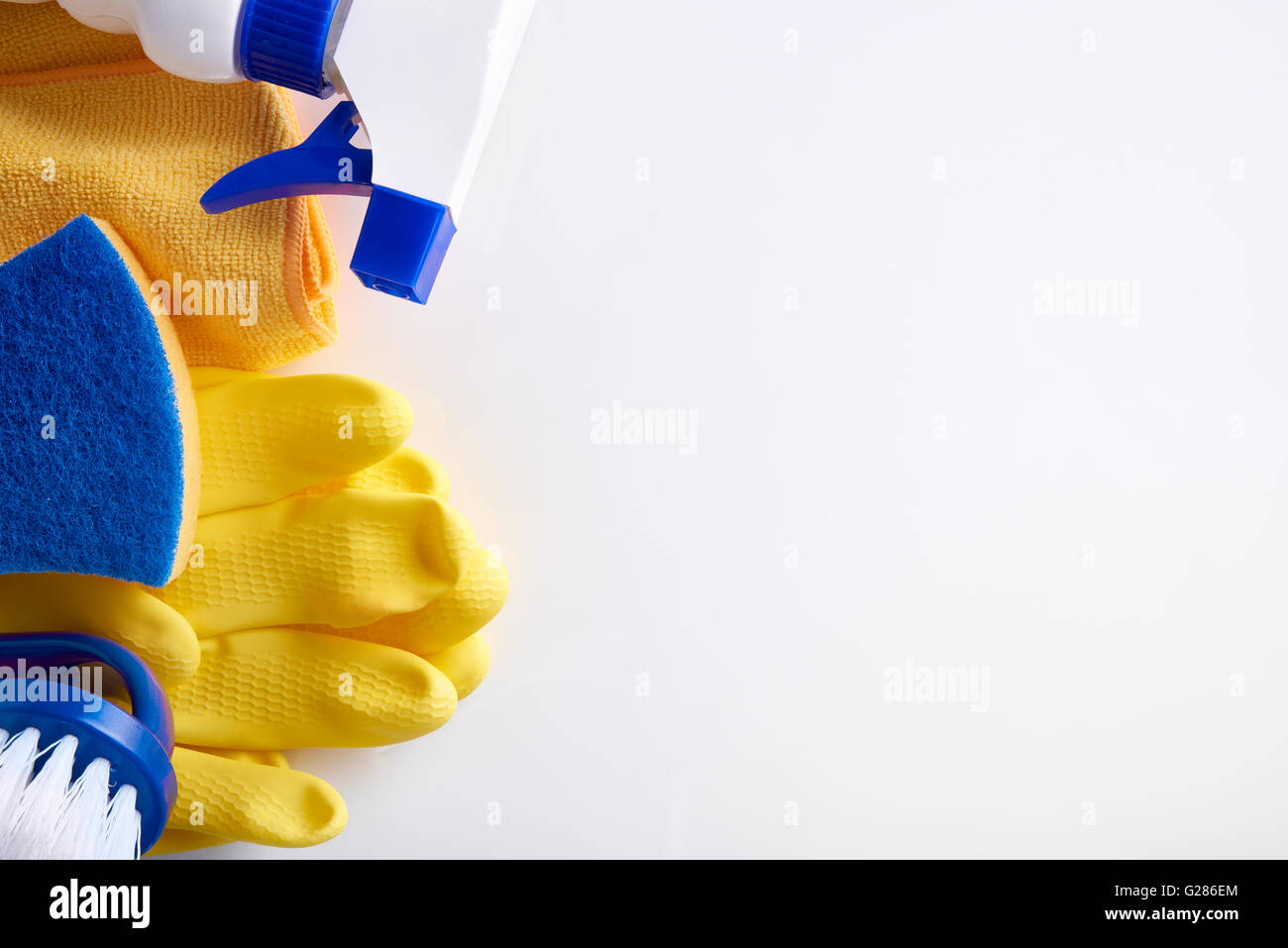 Professional cleaning equipment on white table. Cleaning tools company concept. Top view. Horizontal composition. - Stock Image