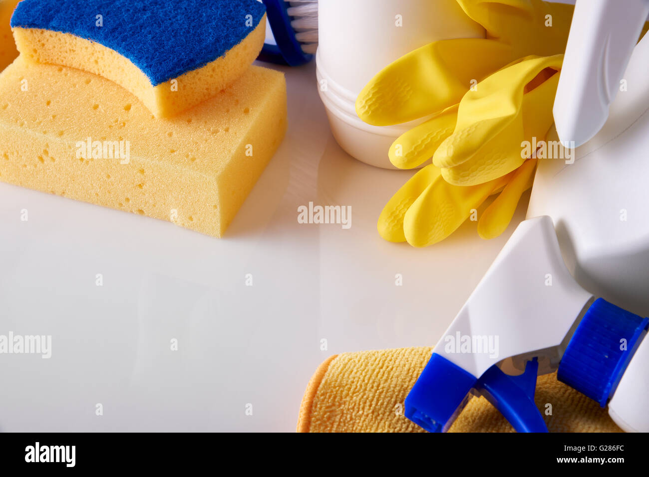 Professional cleaning equipment on white table. Cleaning tools company concept. Elevated view. Horizontal composition. - Stock Image