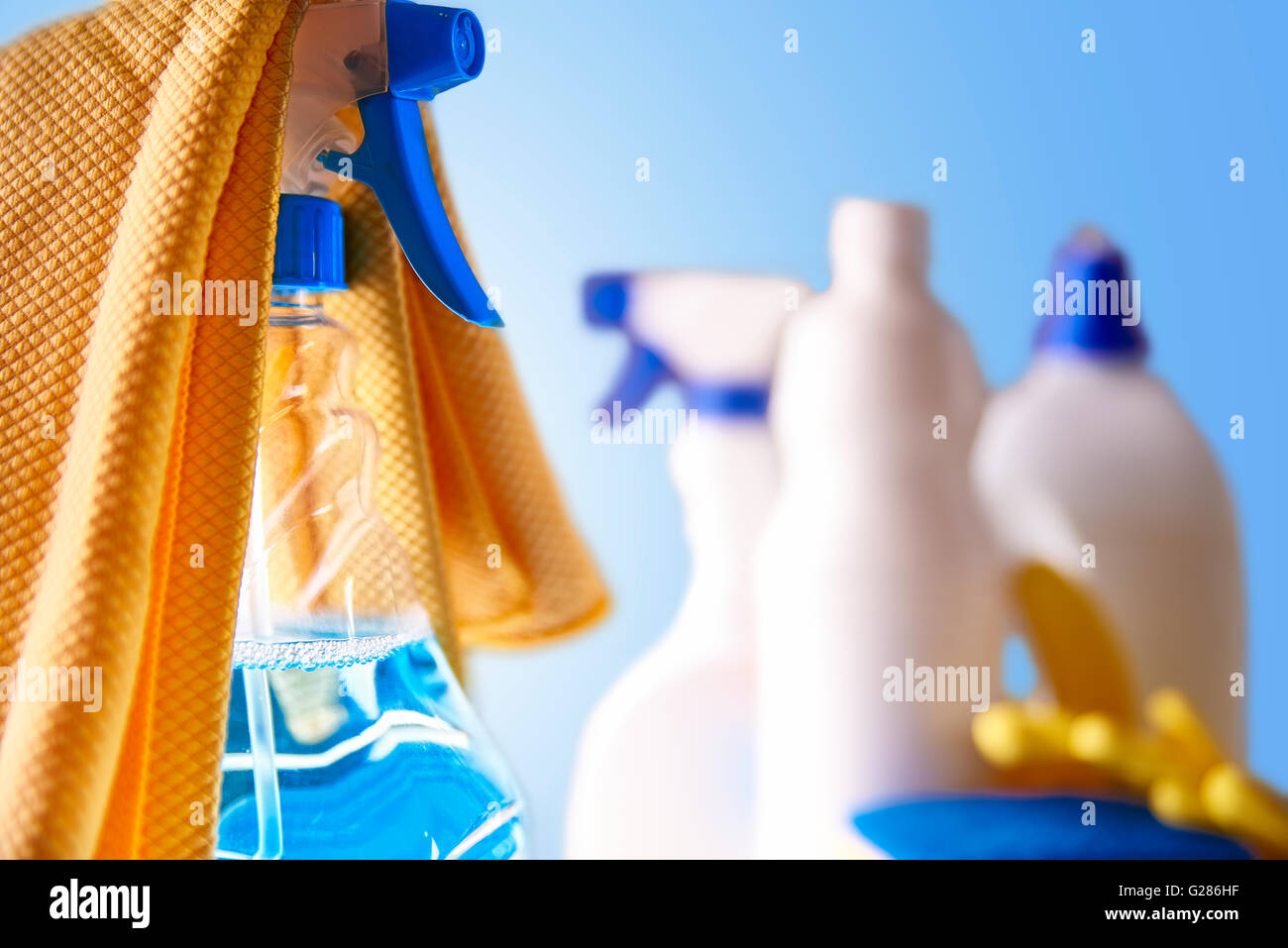Professional cleaning equipment on white table and blue background. Cleaning tools company concept. Front view. - Stock Image