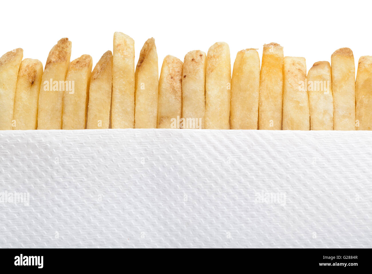 Row of french fries and paper napkin - Stock Image