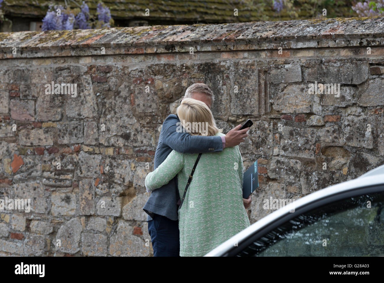 Affectionate embrace in a public place Ely Cambridgeshire England UK - Stock Image