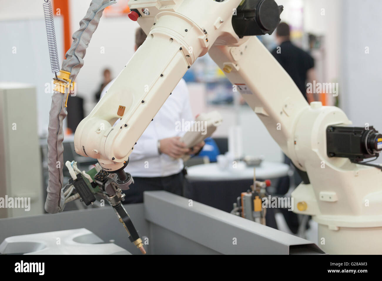 Industrial welding robot arm - Stock Image