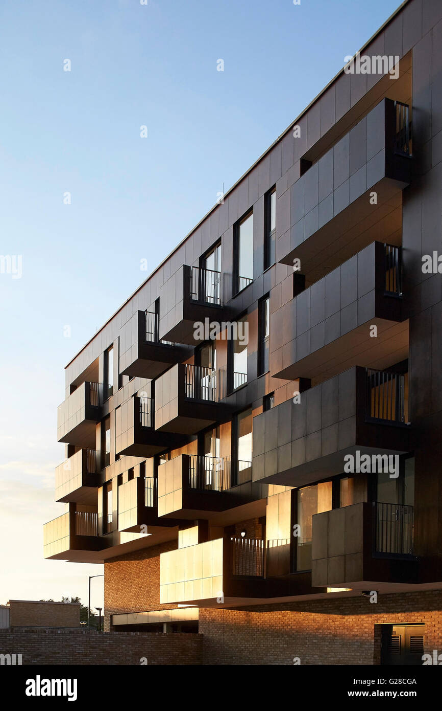 Facade perspective with protruding balconies with late afternoon night. Alpine Place, Brent, London, United Kingdom. - Stock Image