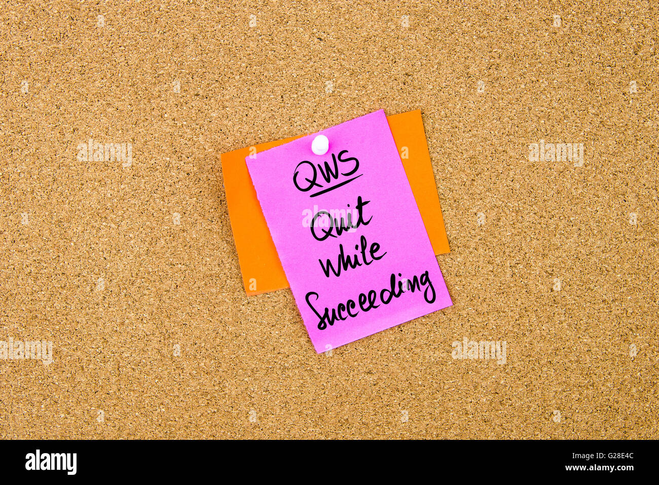 Business Acronym QWS Quit While Succeeding written on paper note pinned on cork board with white thumbtack, copy - Stock Image