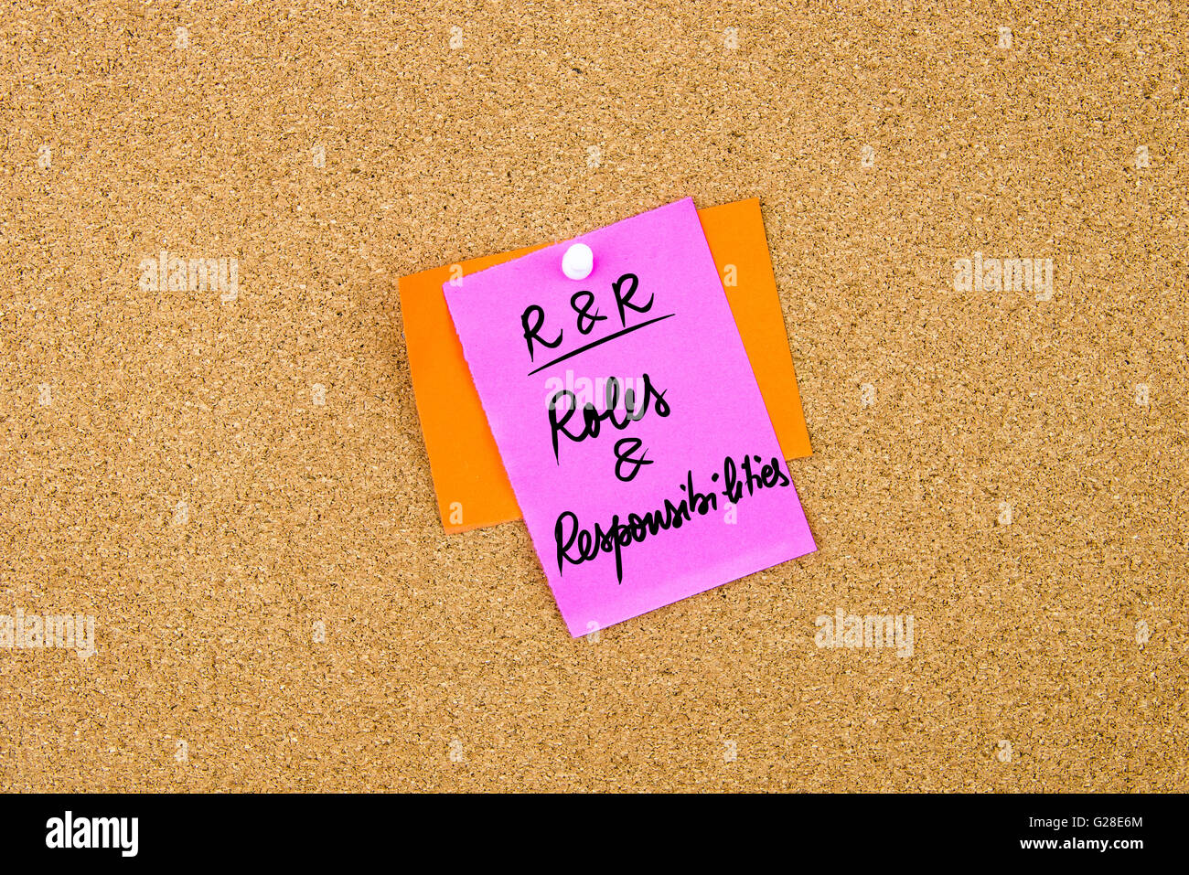 Business Acronym RR Roles and Responsibilities written on paper note pinned on cork board with white thumbtack, - Stock Image