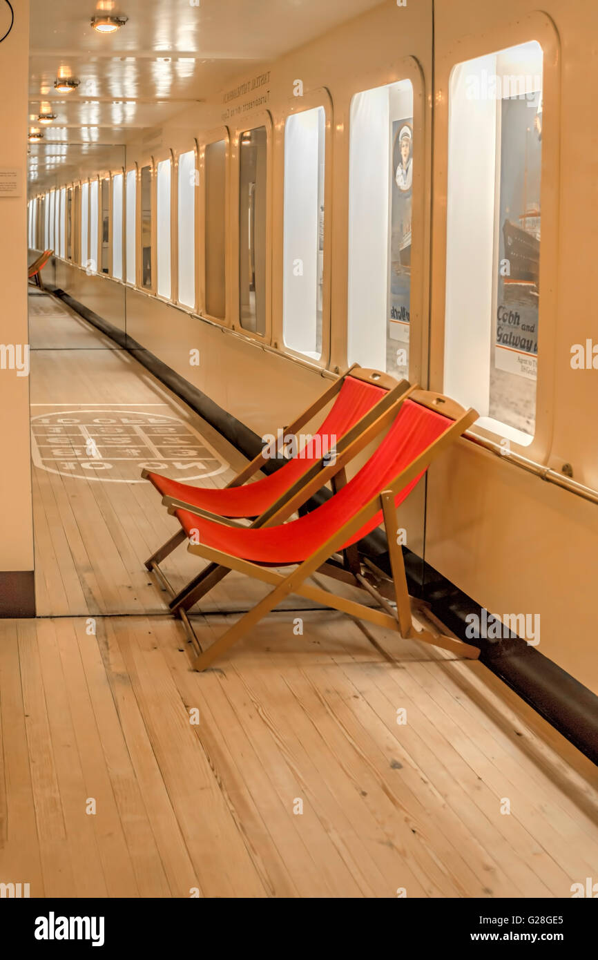 Red deckchairs, part of an exhibition called ''Travelling for pleasure- tourism between the wars'', - Stock Image