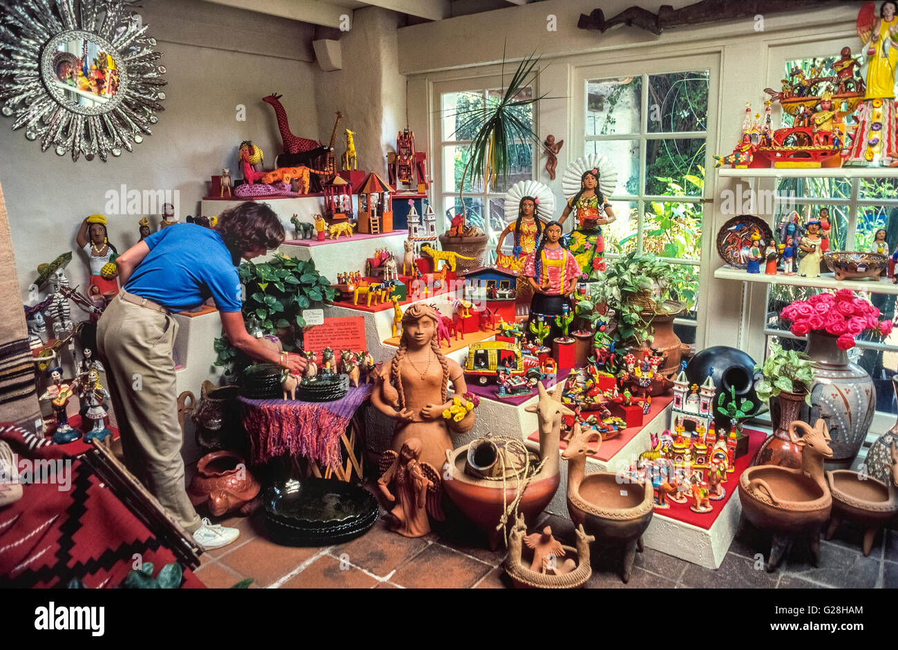 Colorful folk art from Mexico is displayed in an arts and crafts shop in Old Town in San Diego, California, USA. - Stock Image