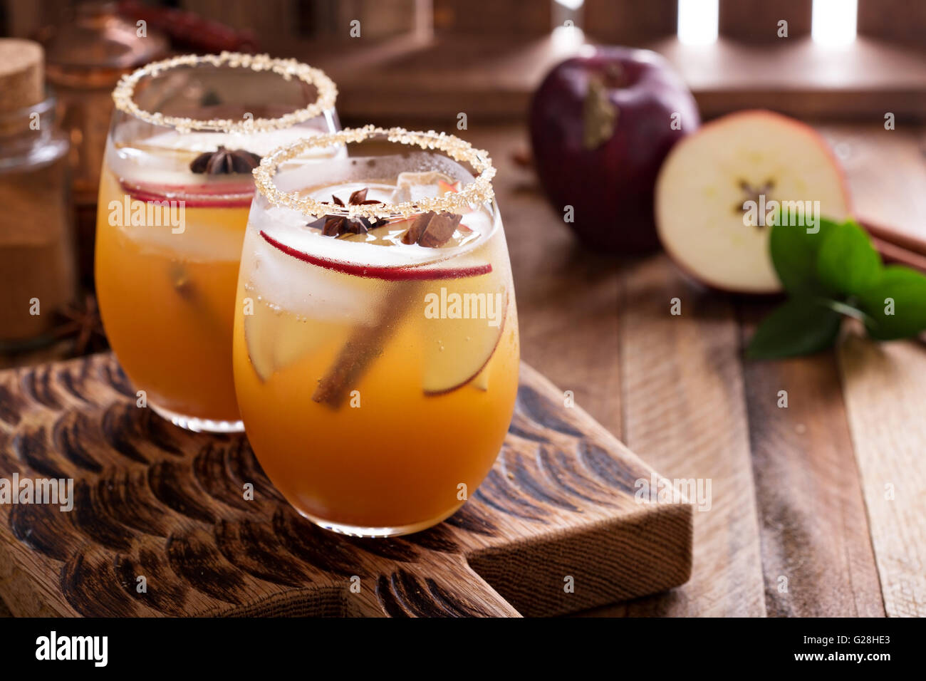 Apple cider cocktail with cinnamon - Stock Image
