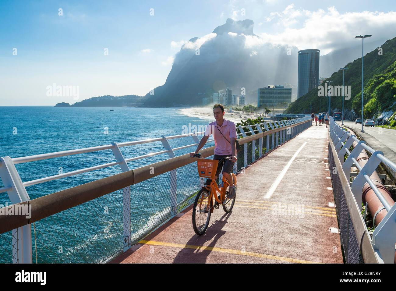 RIO DE JANEIRO - MARCH 19, 2016: A cyclist rides on the newly completed Ciclovia Tim Maia bike path, an Olympics - Stock Image
