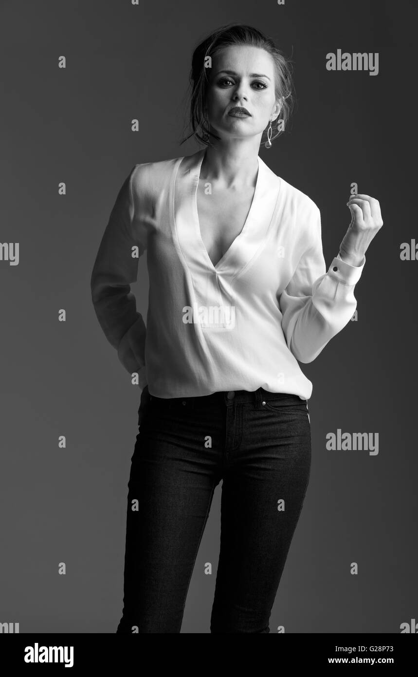 Contemporary Woman In Black And White Aesthetic Portrait Of Modern Elegant Against Grey Background