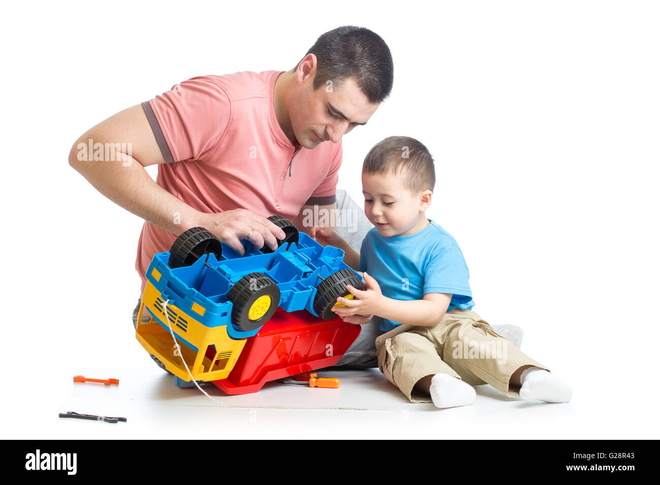 kid boy and his daddy fixing toy trunk - Stock Image