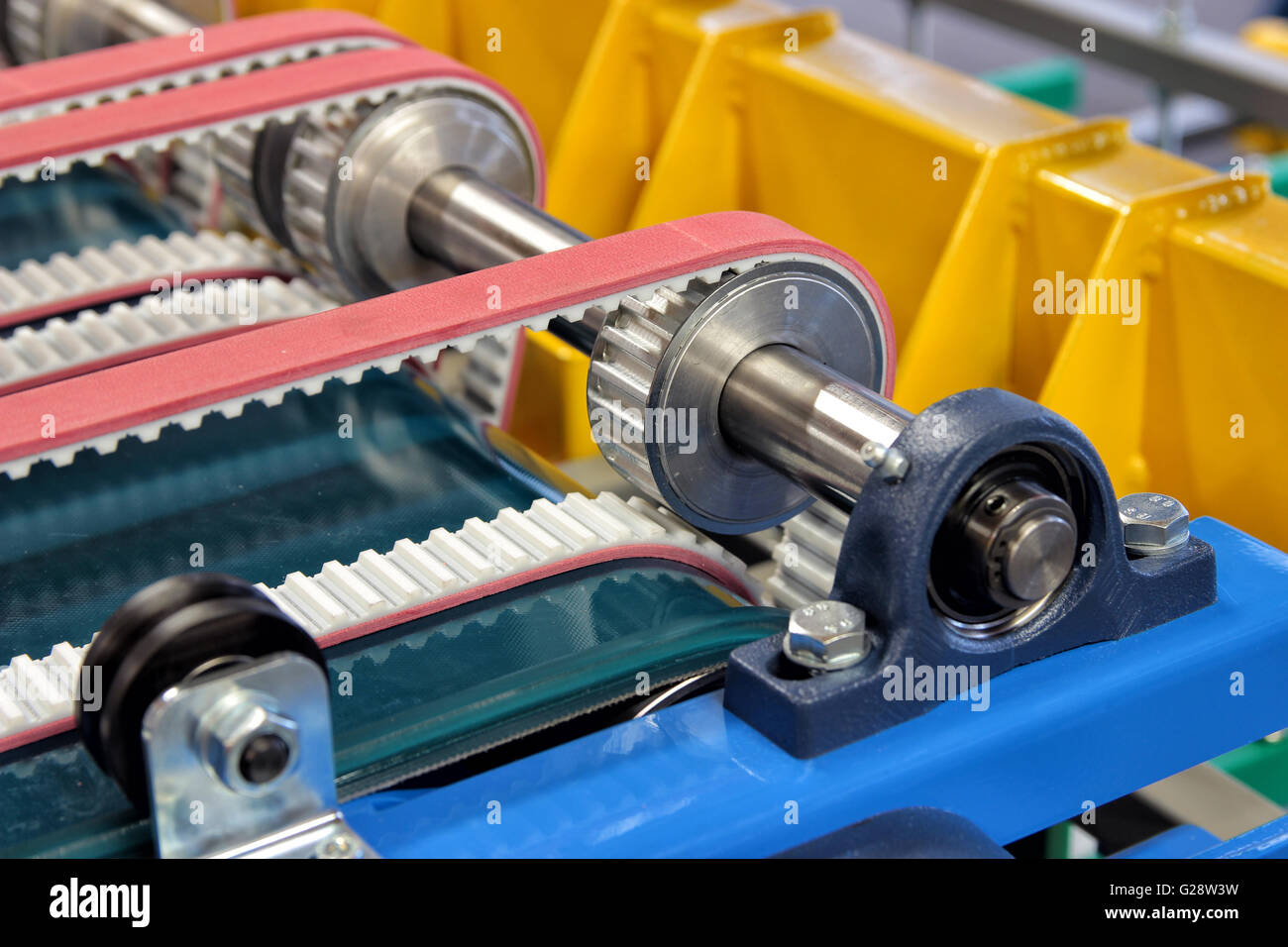 Detail of an equipment fitted with belts and pulleys - Stock Image