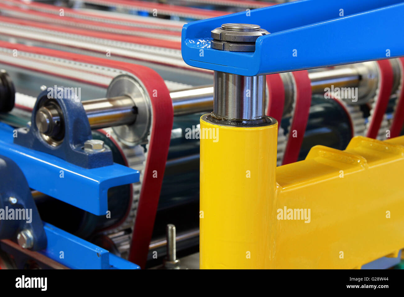 Detail of an equipment fitted with belts, pulleys and pistons - Stock Image