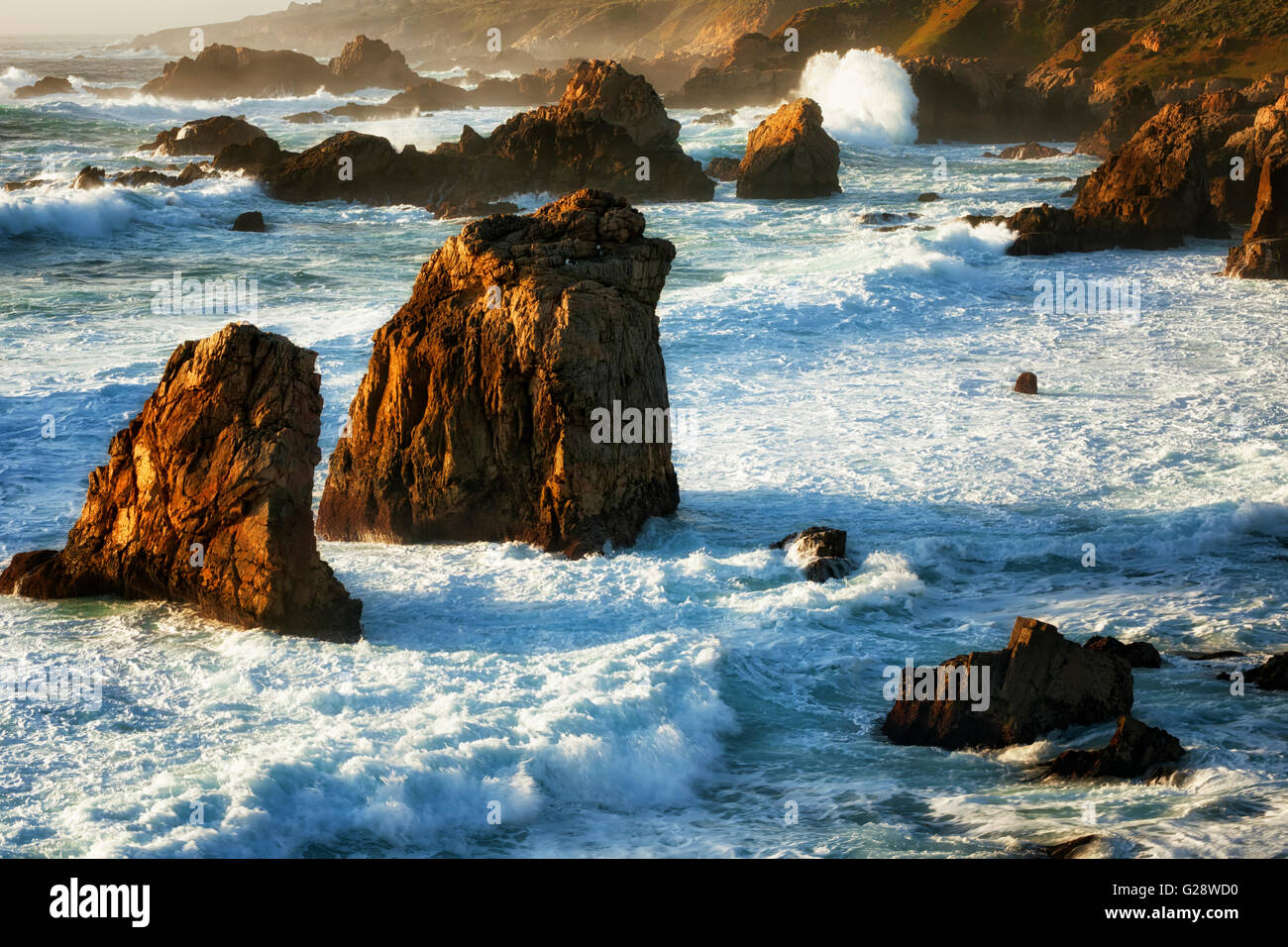 Evening light beauty on the crashing waves and sea stacks at Garrapata State Park along California's Big Sur Coast. - Stock Image