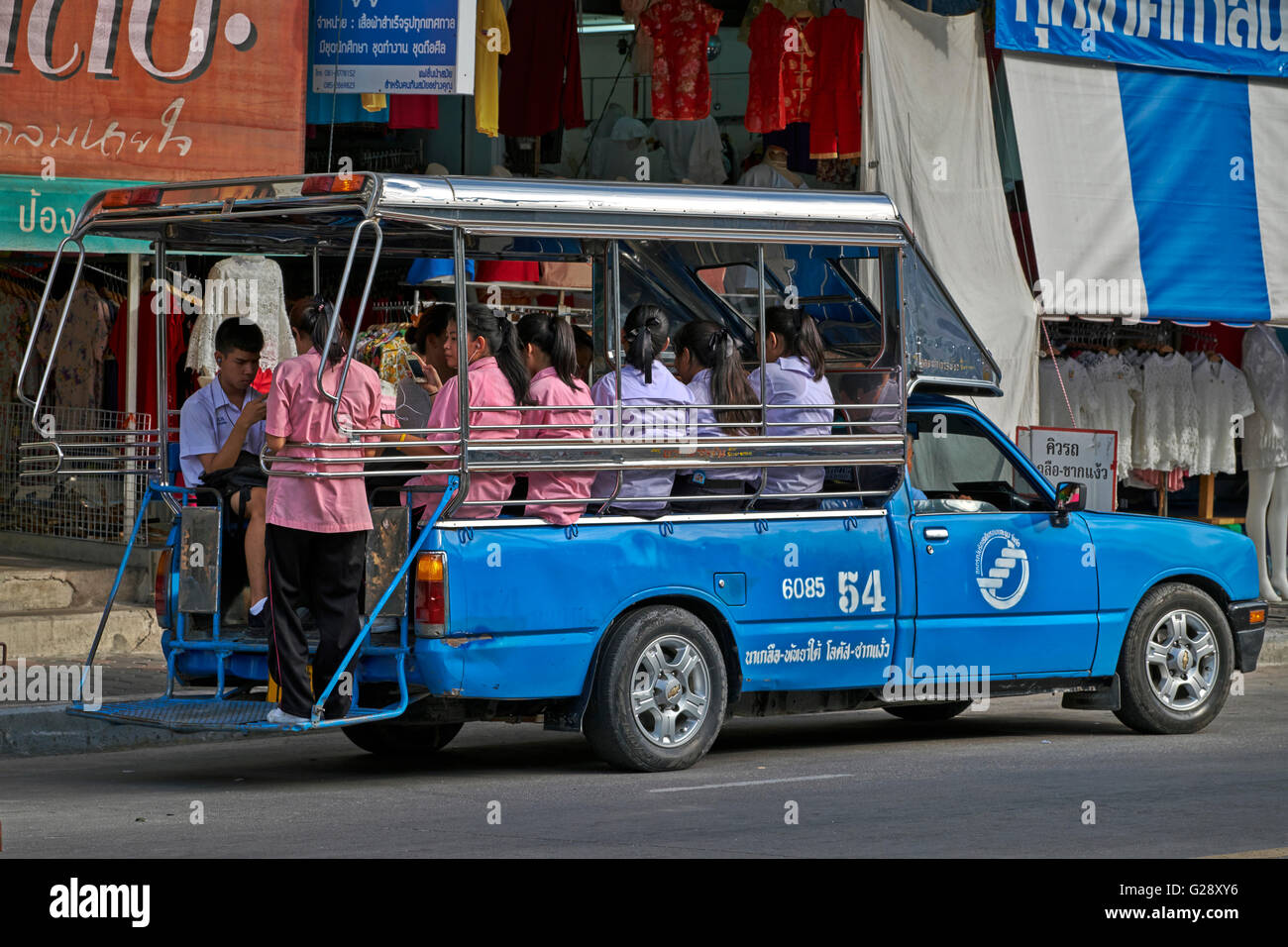 Fully loaded Thai songthaew public transport car. Thailand S. E. Asia - Stock Image