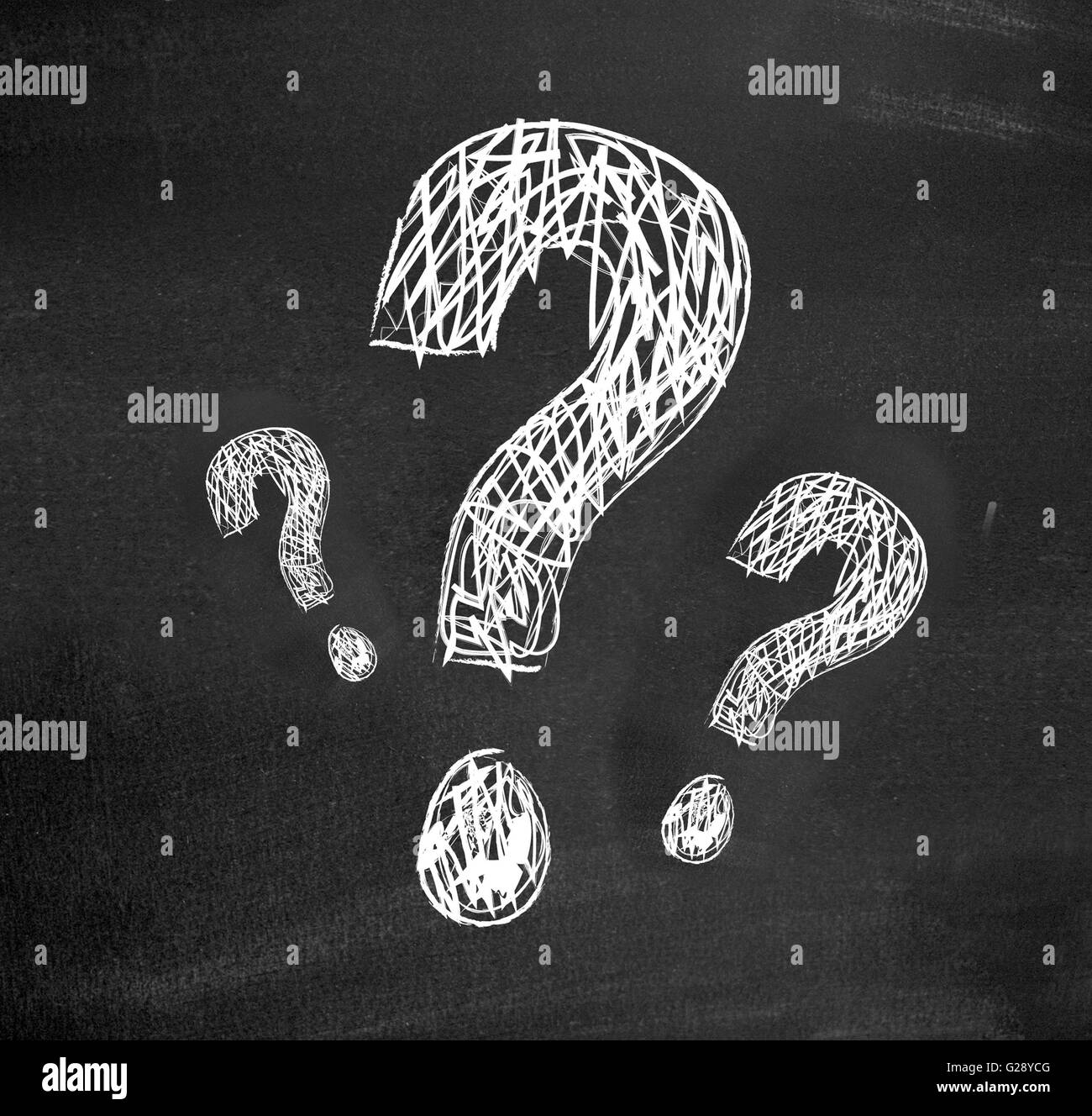 Questions on a blackboard - Stock Image