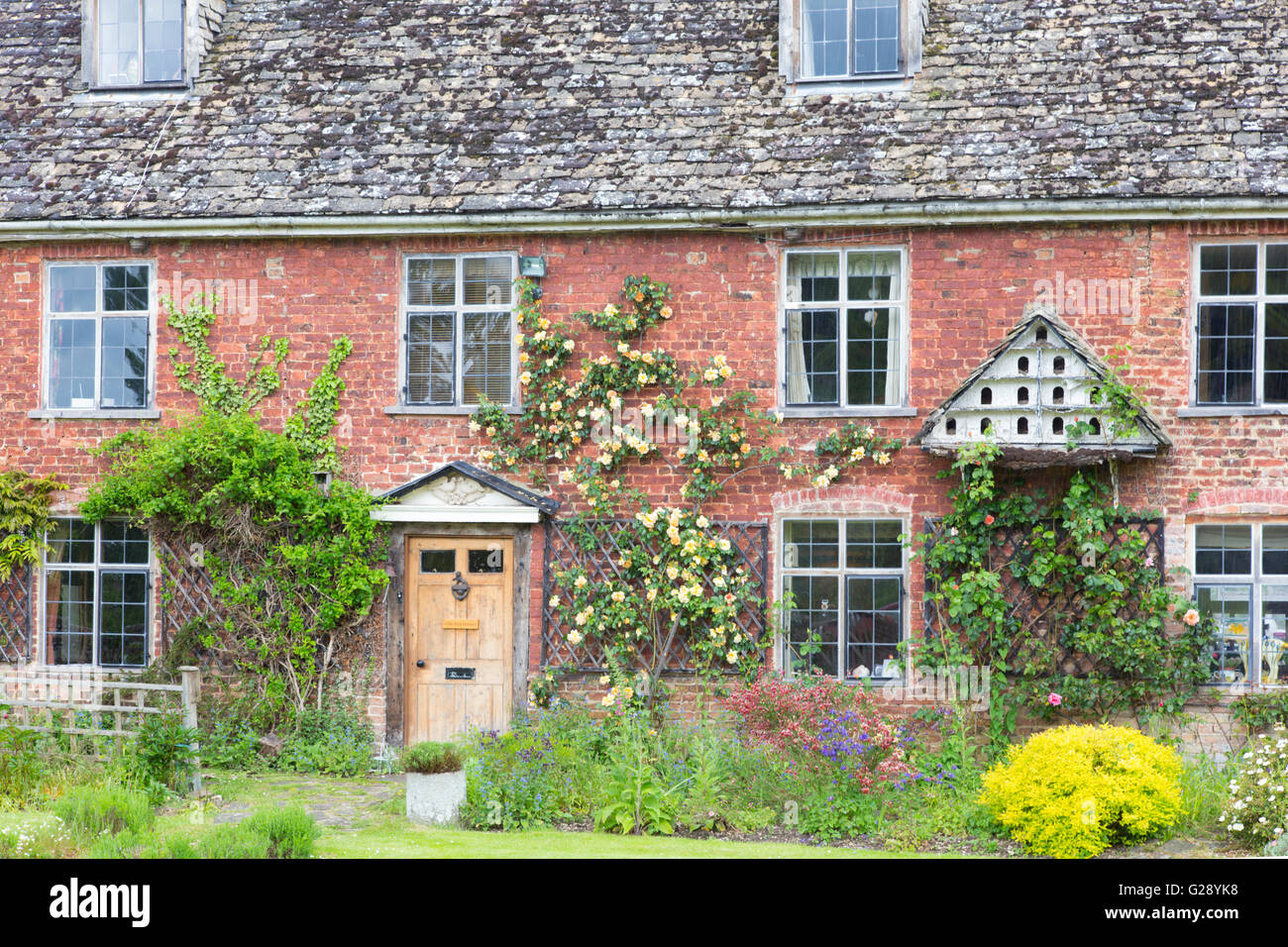 A picturesque country cottage, Gloucestershire, England, UK - Stock Image