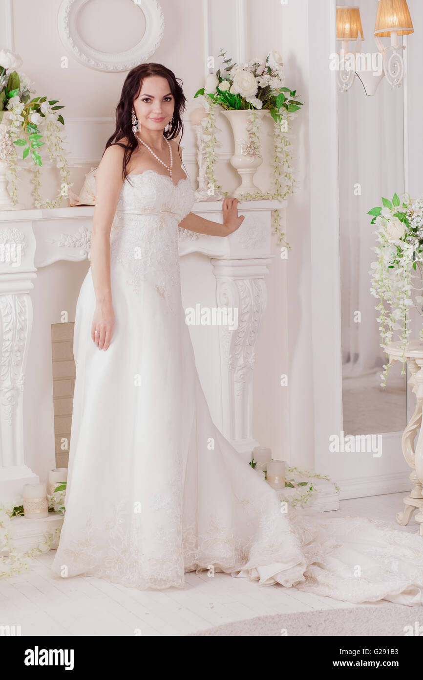 Wedding dress Paris. luxury apartment in a dress. Bride near the ...