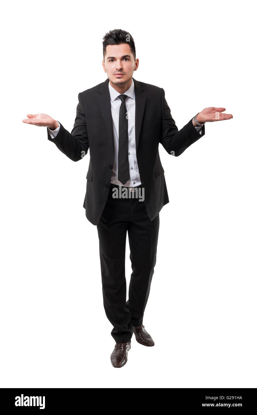 Handsome brunet business man asking a question using his hands, all isolated on white background - Stock Image