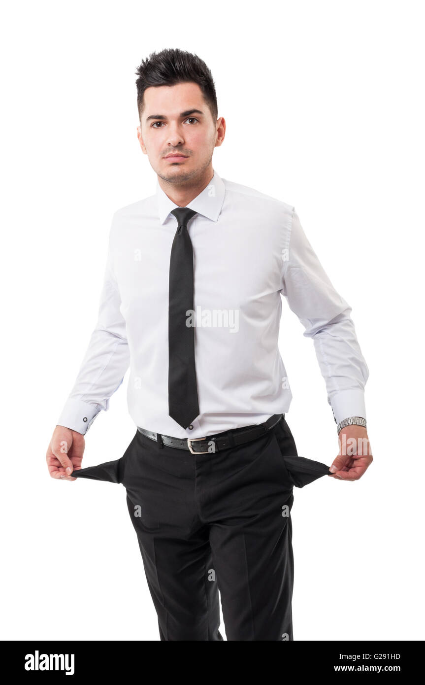 Broke businessman showing his empty pockets - Stock Image