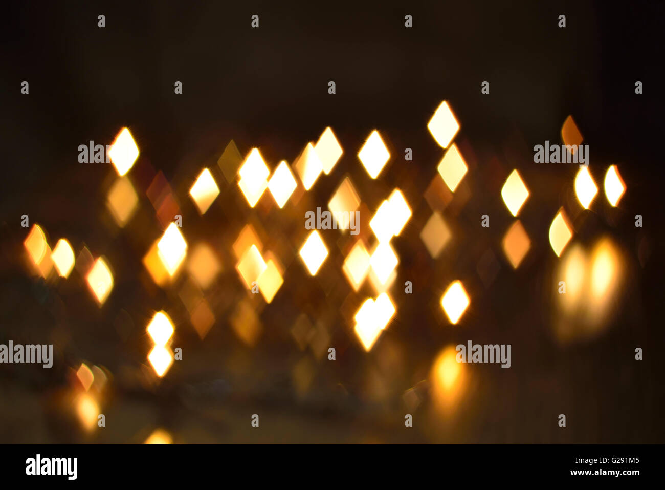 luminous rhombus flying in darkness abstract blur background - Stock Image