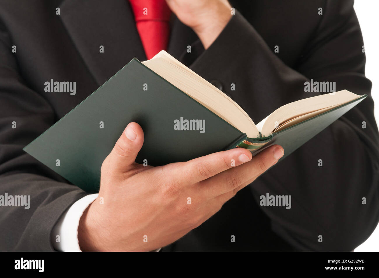 Business man or lawyer hand holding a book - Stock Image