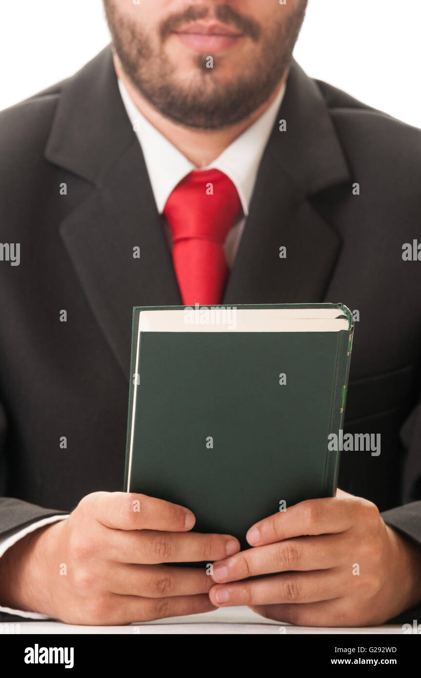 Elegant lawyer with black suit and red tie holding a book - Stock Image