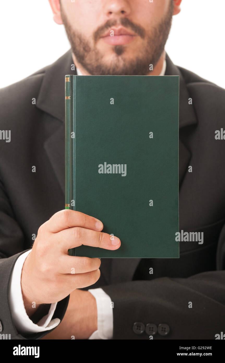 Elegant preacher holding a book of prayers - Stock Image