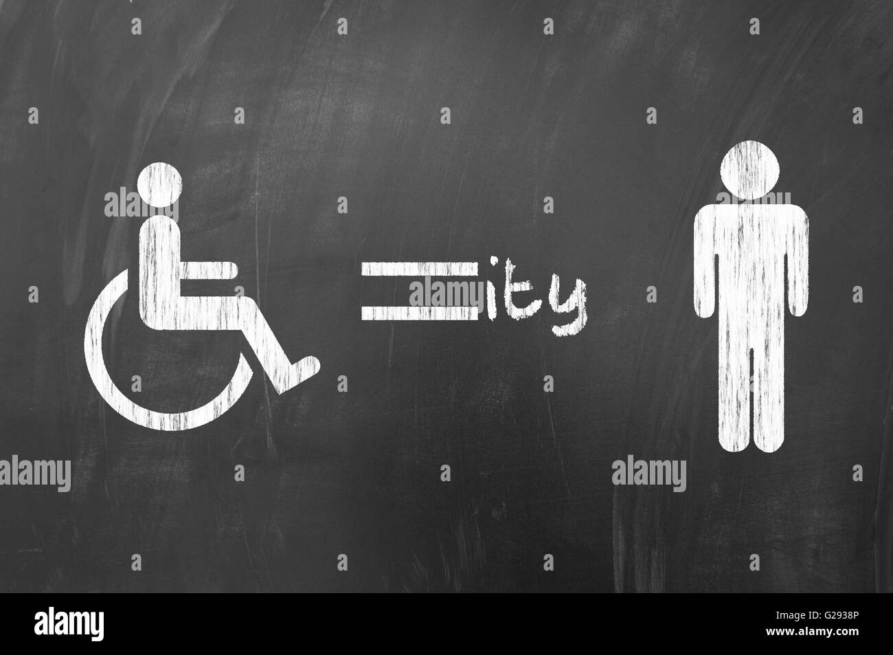 Disability equality concept on blackboard - Stock Image