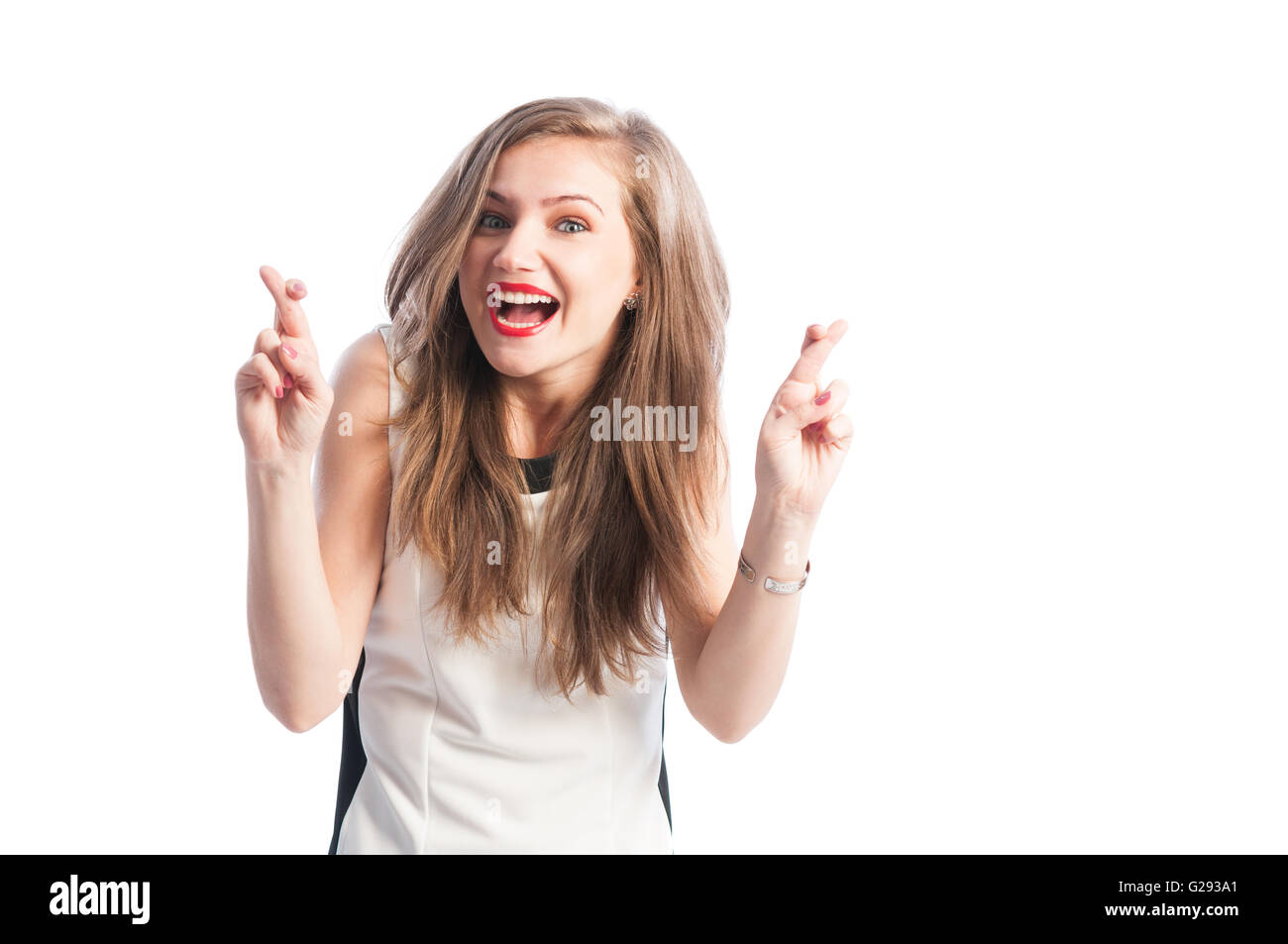 Woman holding fingers crossed - Stock Image
