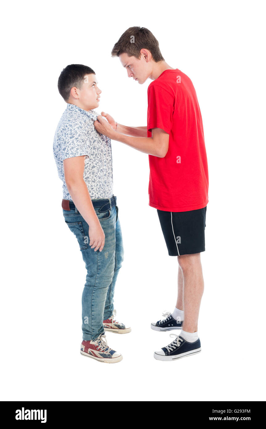 Older boy bullying younger kid concept isolated on white background. - Stock Image