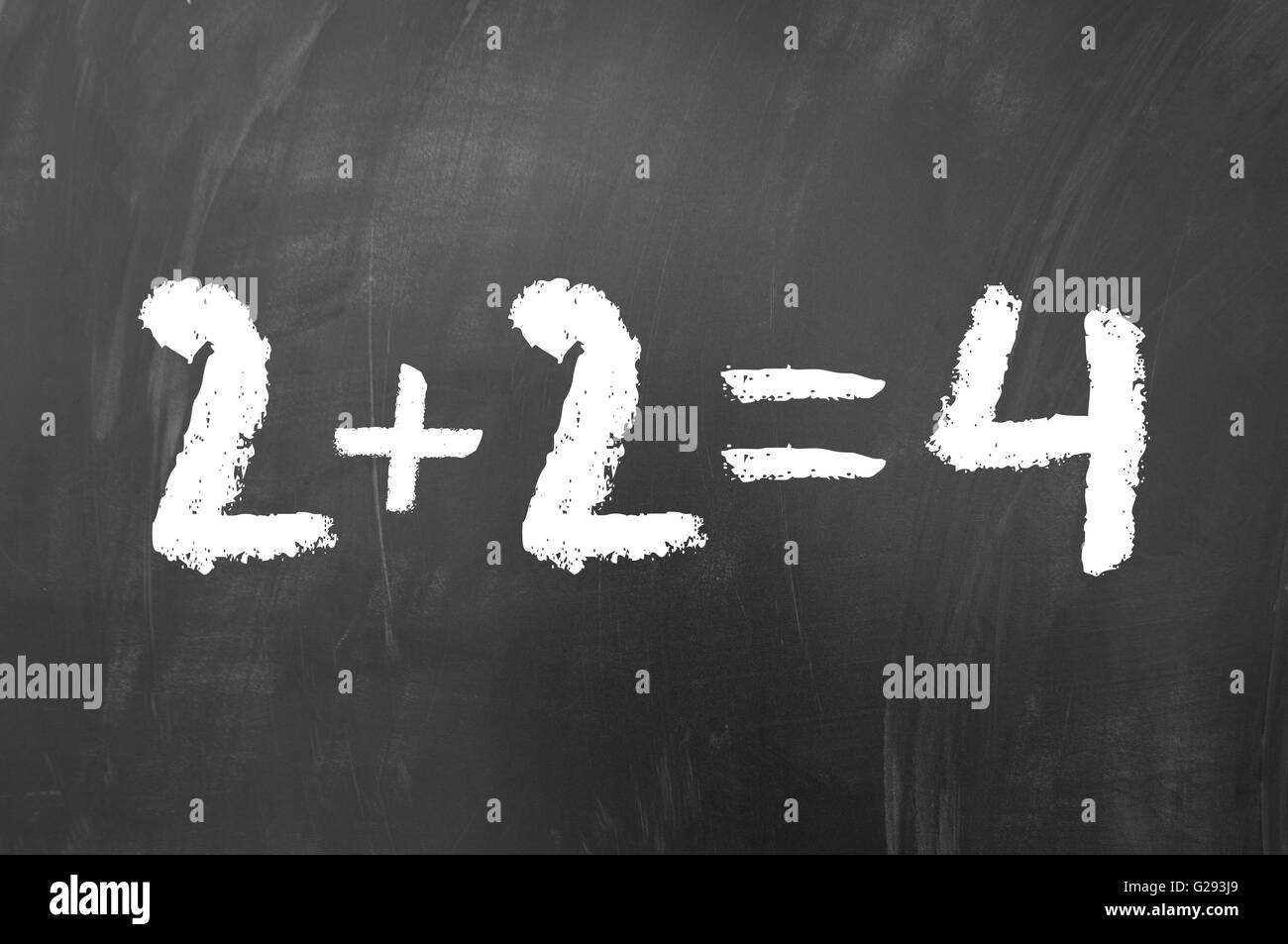 2 plus 2 equals 4 simple math problem solved on a school blackboard ...