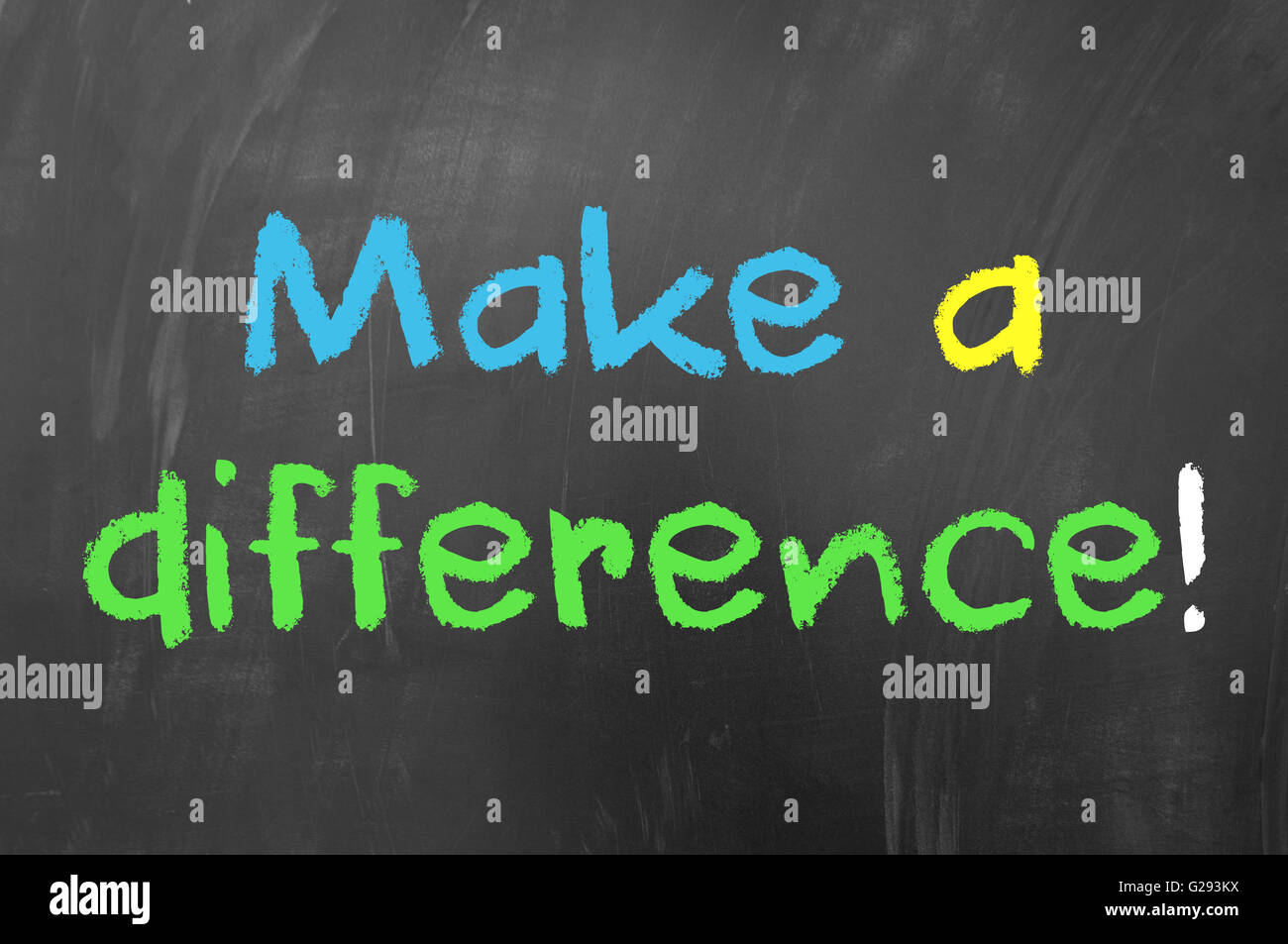 Make a difference concept written with chalk on blackboard - Stock Image