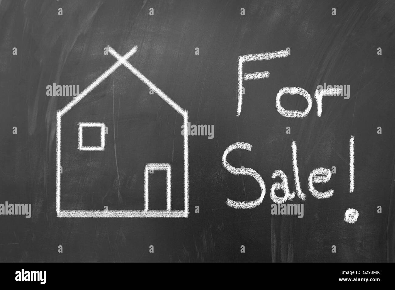 House for sale concept made with white chalk on blackboard - Stock Image
