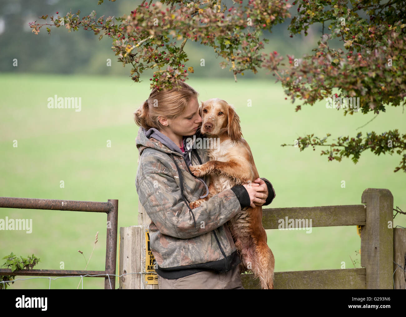 girl with cocker spaniel - Stock Image