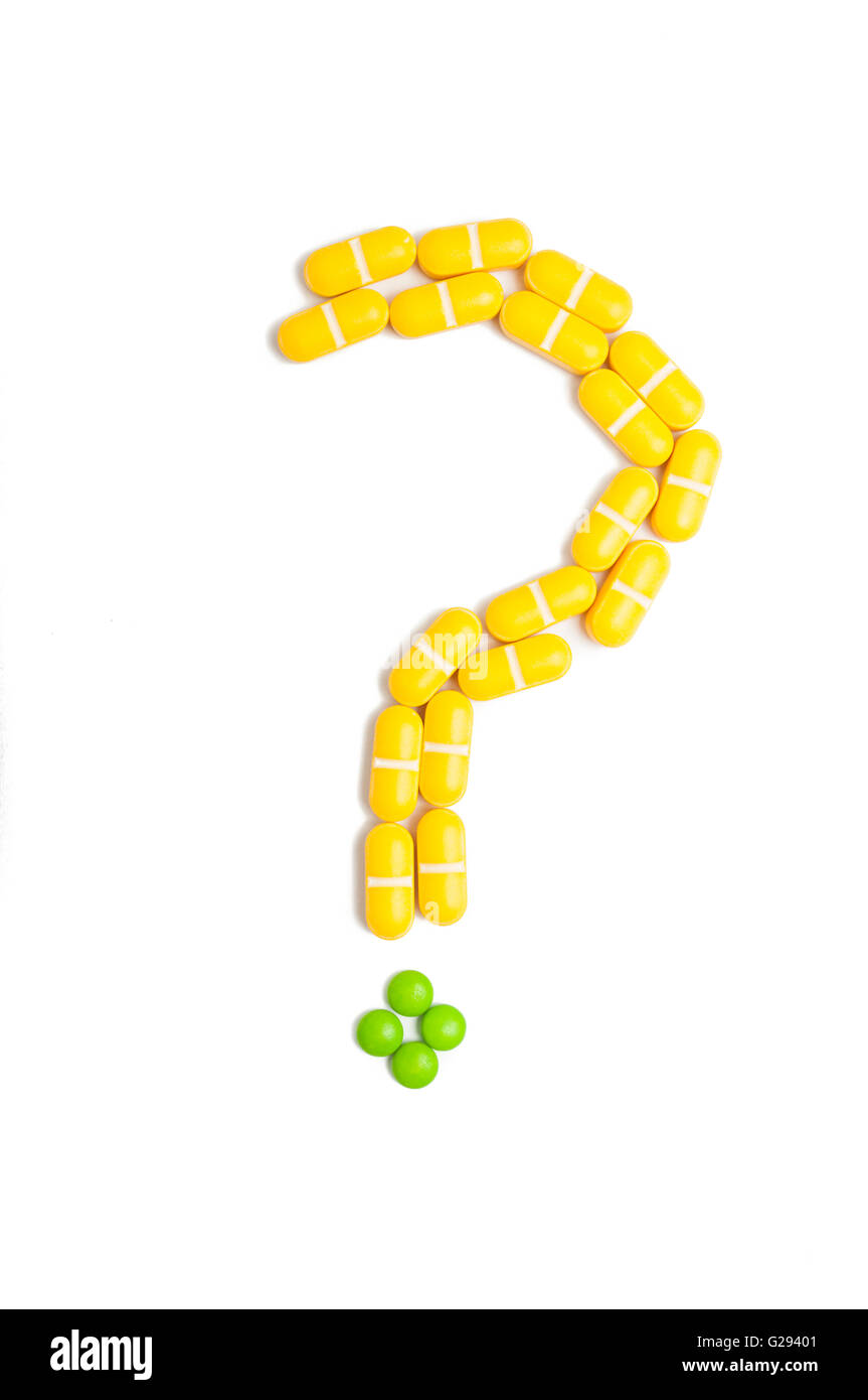 Question mark made from pills isolated on white background - Stock Image