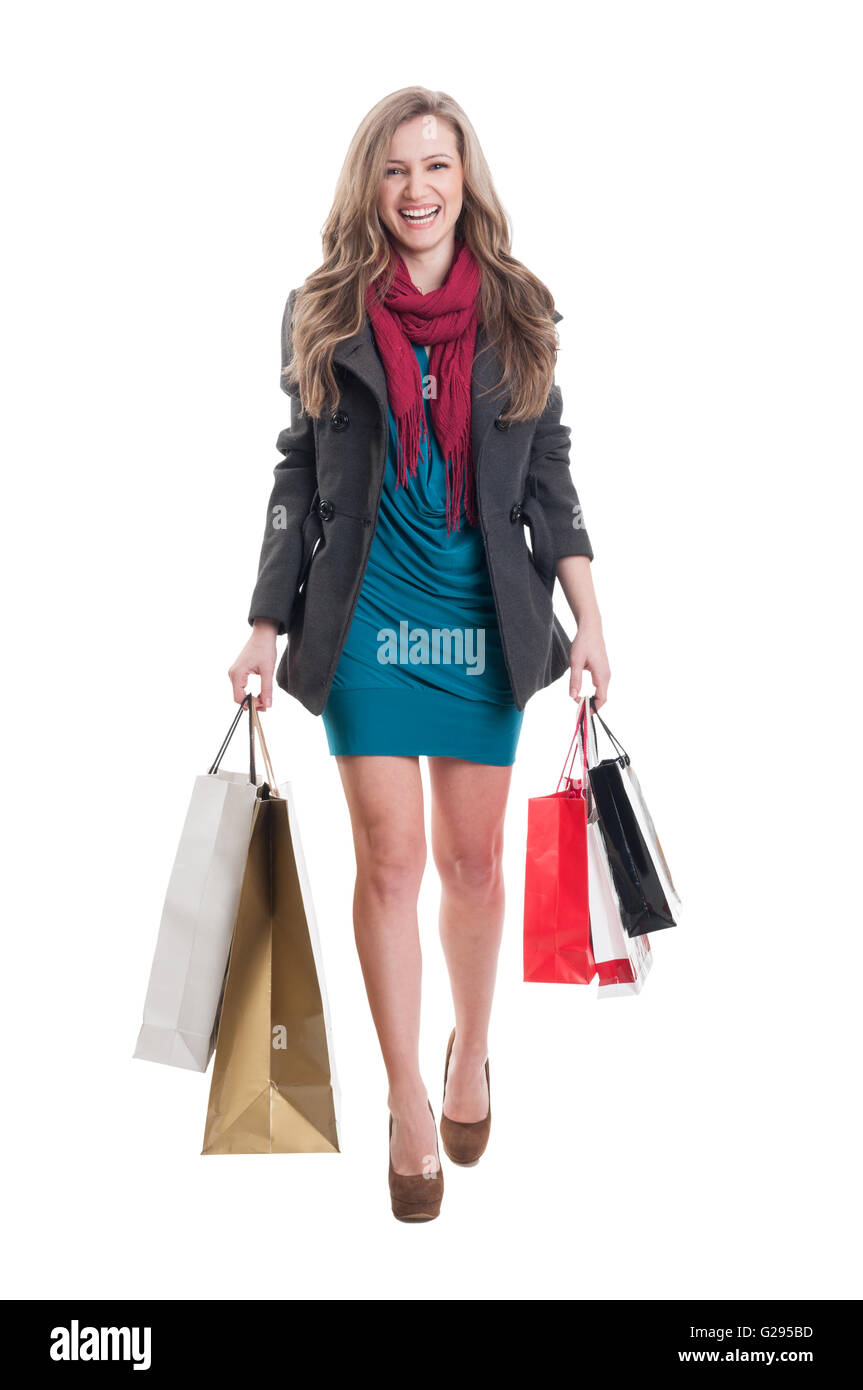 Jolly shopping female carrying paper bags - Stock Image