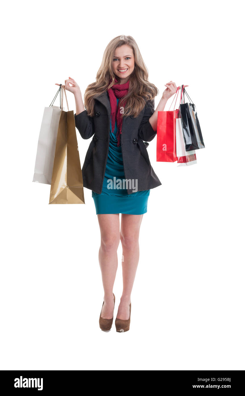 Cheerful shopping girl expressing happiness on white background - Stock Image